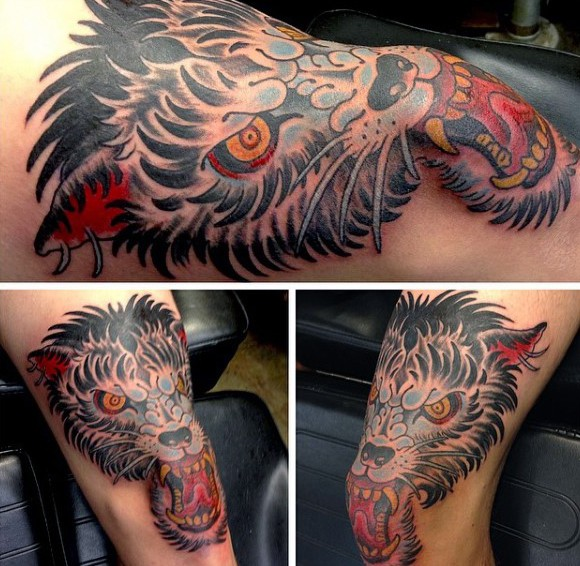 Old school style colored leg tattoo of evil wolf