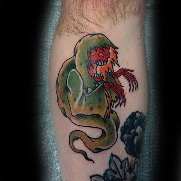 Old school style colored leg tattoo of funny monster ghost