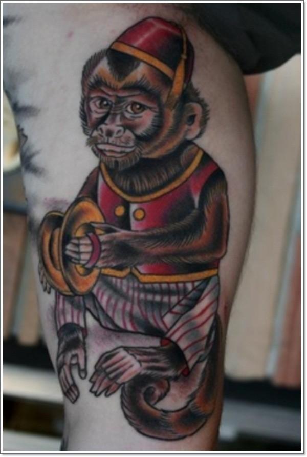 Old school style colored little cute monkey tattoo on leg