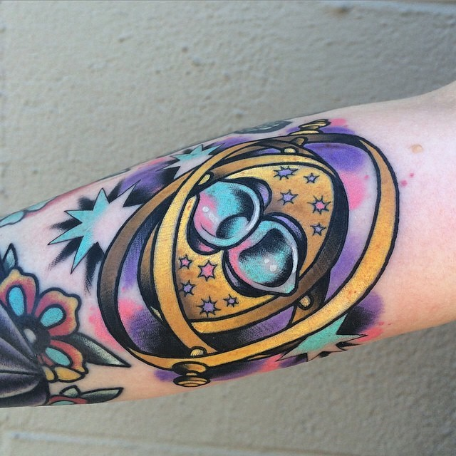 Old school style colored little magical mechanism tattoo on forearm with stars