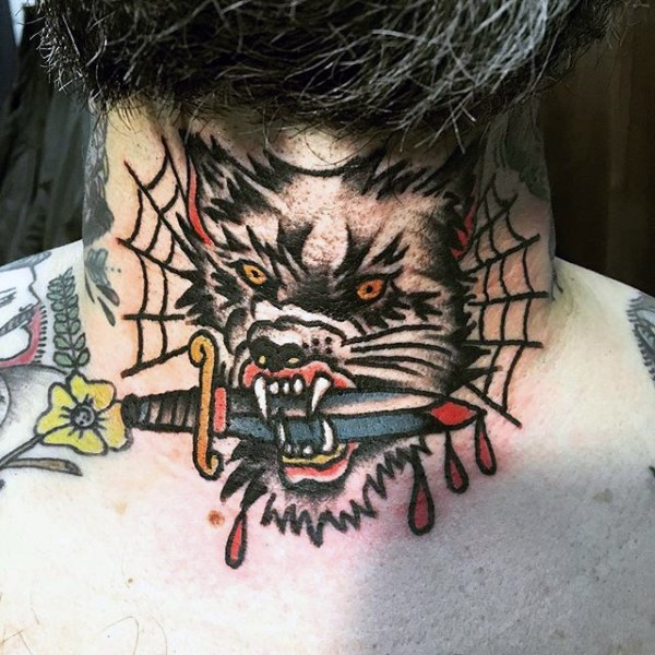 Old school style colored mad wolf with bloody dagger in mouth tattoo on neck with spiderweb