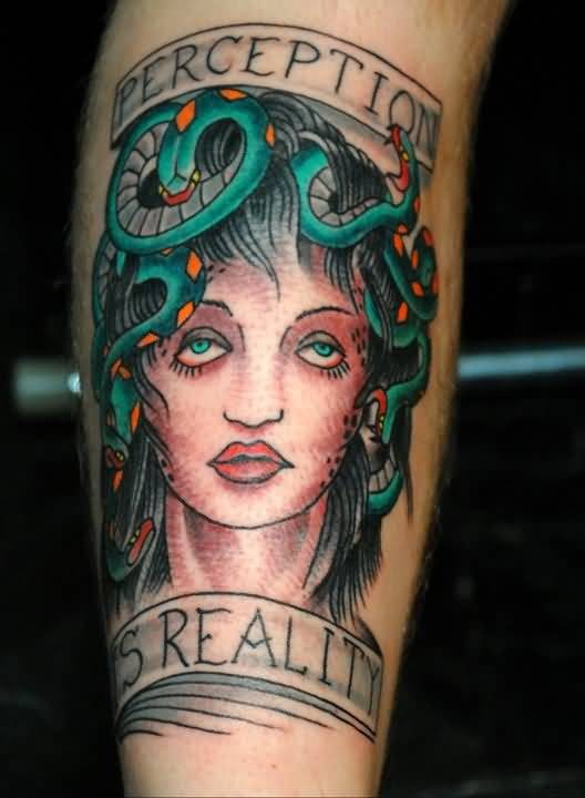 Old school style colored Medusa Gorgon mystique creature tattoo on forearm with banner lettering