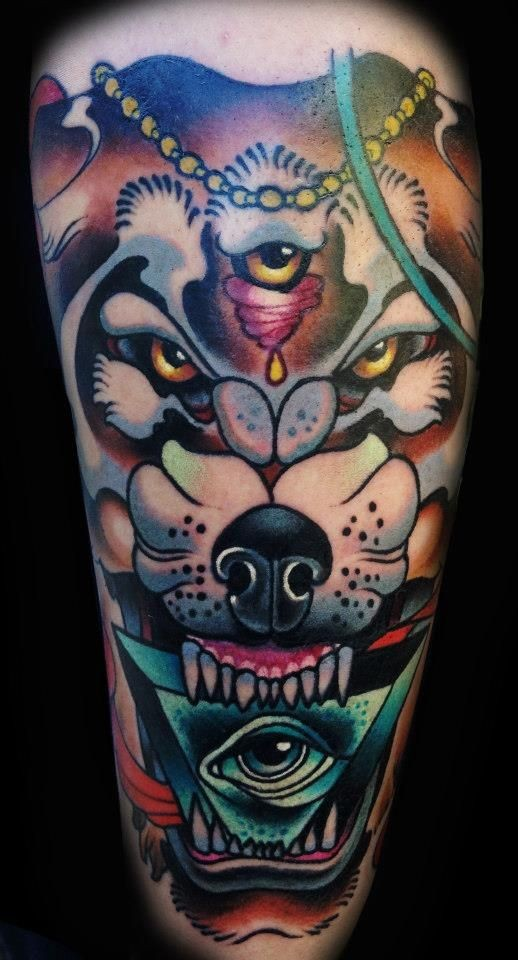Old school style colored mystical wolf with pyramid eye tattoo