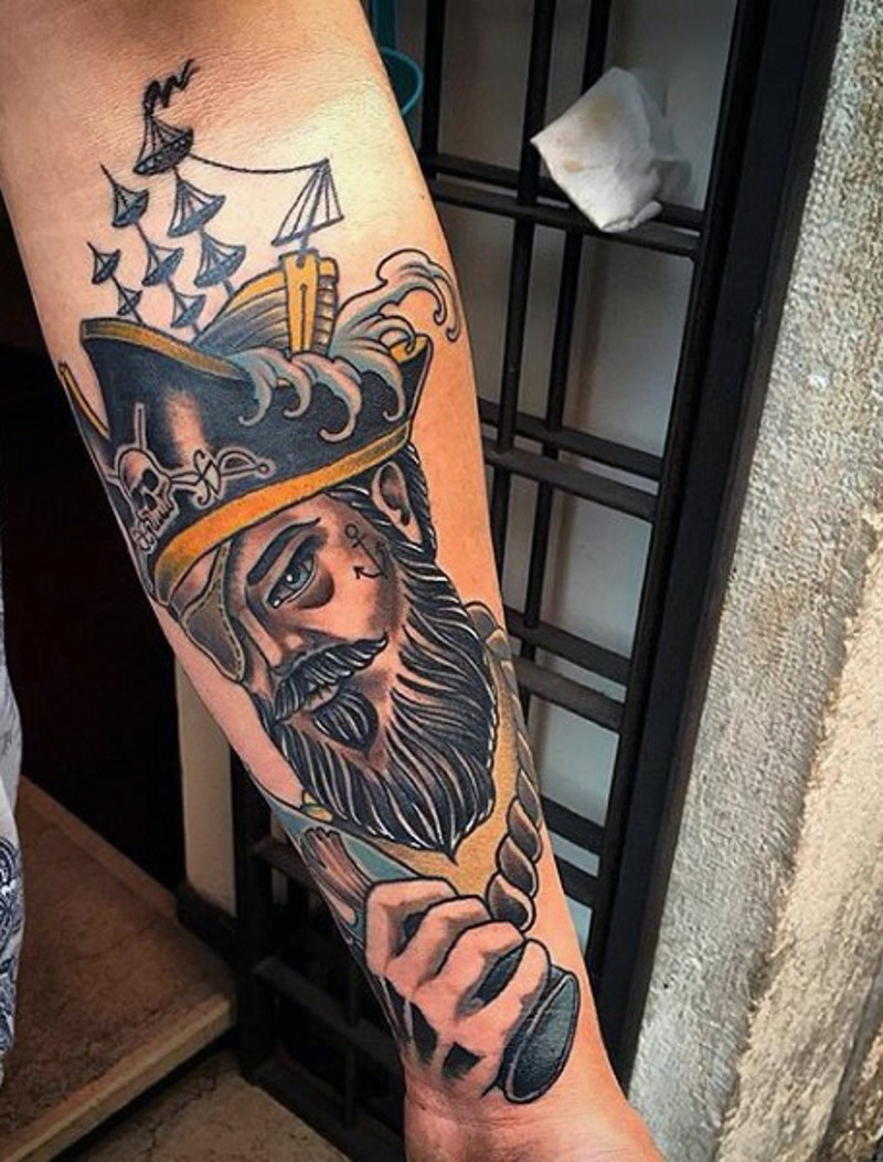 Old school style colored old pirate tattoo on arm