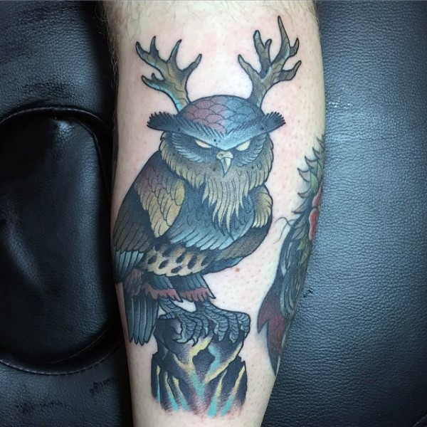 Old school style colored owl with horns weird colored forearm tattoo