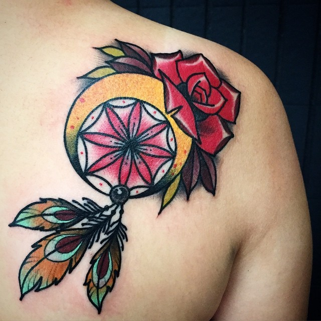 Old school style colored scapular tattoo of dream catcher with rose
