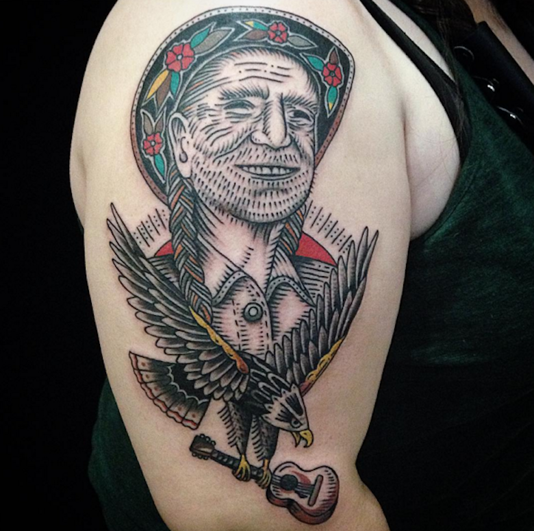 Old school style colored shoulder tattoo of old Indian with crow and guitar