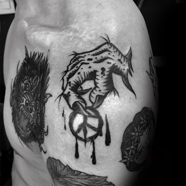 Old school style colored shoulder tattoo of creepy hand and pacific symbol