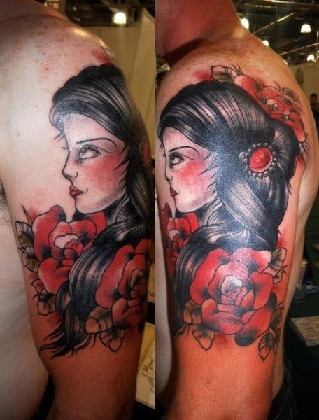 Old school style colored shoulder tattoo of woman with roses