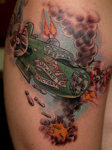 Old school style colored shoulder tattoo of WW2 bomber plane