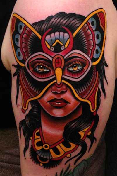 Old school style colored shoulder tattoo of beautiful woman with butterfly mask