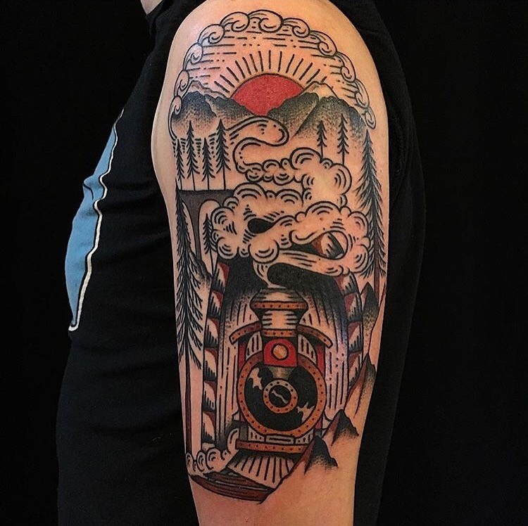 Old school style colored shoulder tattoo of old train with mountain tunnel and sun