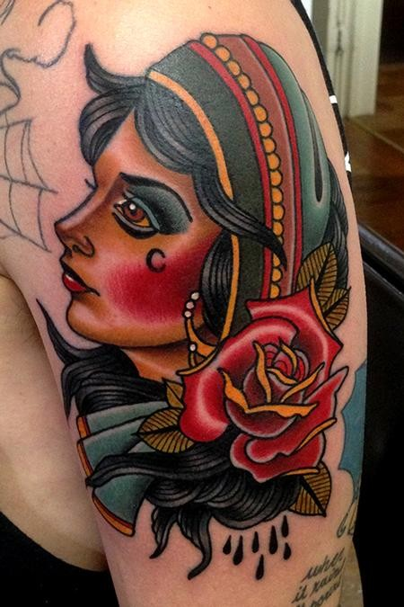 Old school style colored shoulder tattoo of gypsy woman with large rose