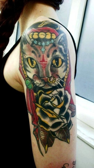 Old school style colored shoulder tattoo of cat stylized with red symbol and black rose