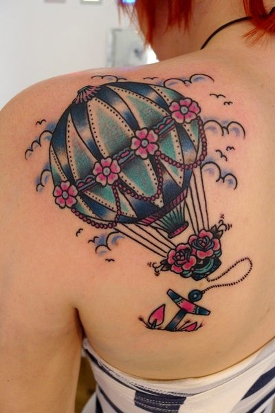 Old school style colored shoulder tattoo of roped balloon stylized with flowers and anchr