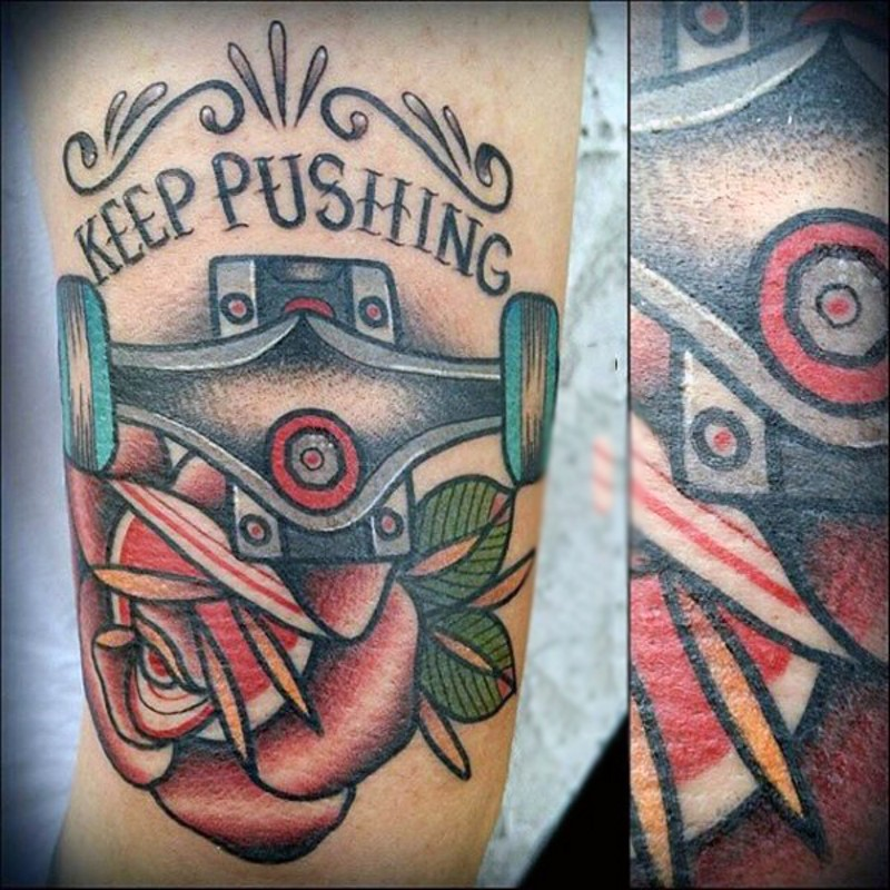 Old school style colored skating dedicated tattoo on arm with lettering and flower