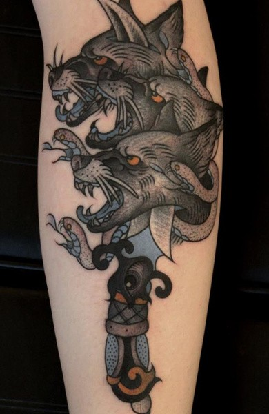 Old school style colored tattoo of Cerberus with snake and dagger