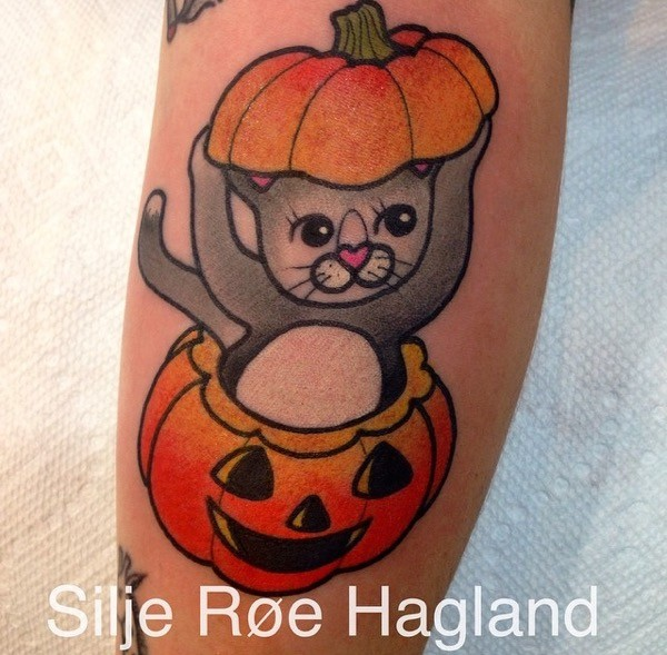 Old school style colored tattoo of cute cat in pumpkin