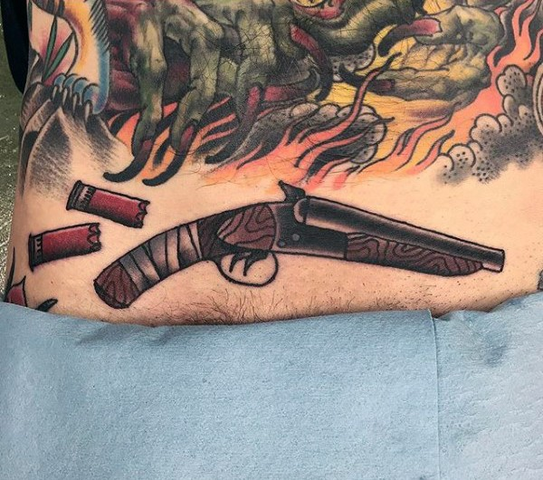 Old school style colored tattoo of old rifle with bullets