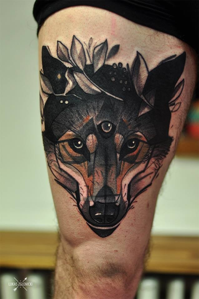 Old school style colored thigh tattoo of wolf with mystic eye