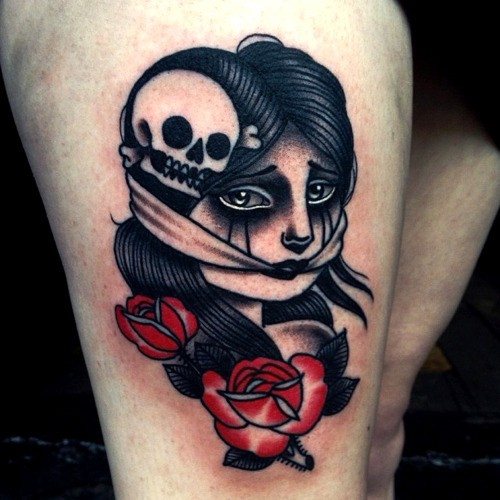 Old school style colored thigh tattoo of scared woman with skull and rose