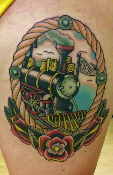 Old school style colored thigh tattoo of train with lettering and flowers