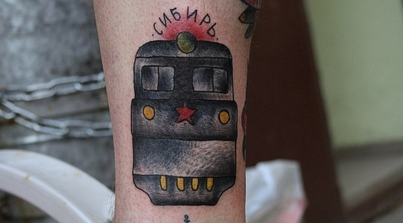 Old school style colored train front view with red star and Russian inscription tattoo