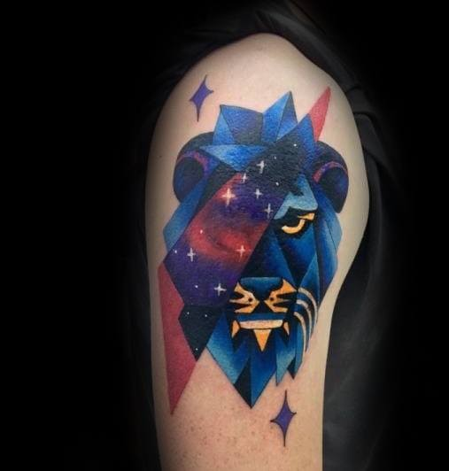 Old school style colored upper arm tattoo of blue lion with stars