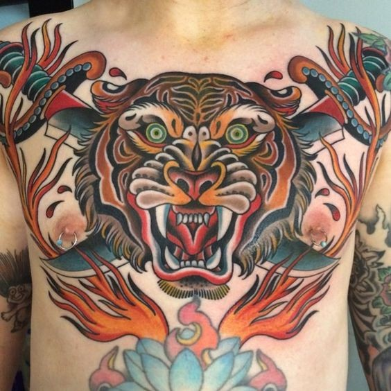 Old school style colorful angry tiger dace with crossed swords tattoo on chest