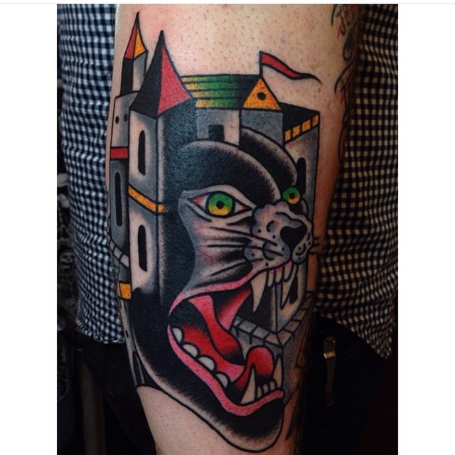 Old school style colorful black panther tattoo on forearm stylized with old castle