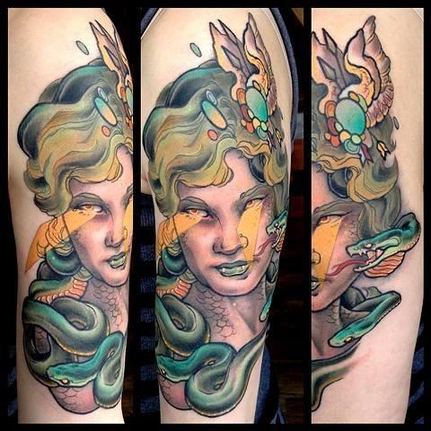 Old school style colorful half sleeve tattoo of evil Medusa