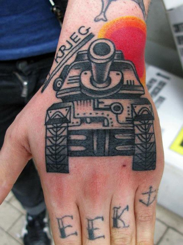 Old school style detailed hand tattoo of old tank and lettering