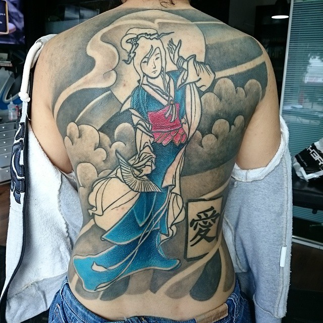 Old school style half colored whole back tattoo of dancing Asian geisha with little symbol