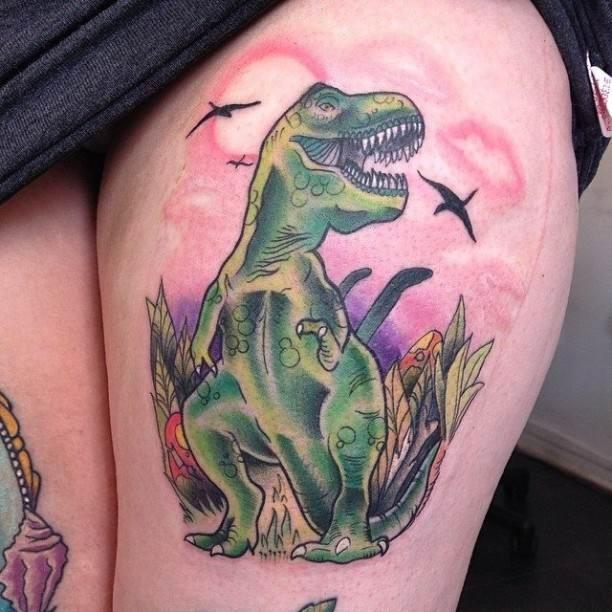 Old school style illustrative dinosaur tattoo on thigh