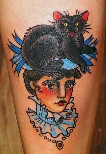 Old school style leg tattoo of beautiful woman with cat