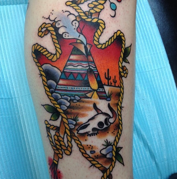Old school style multicolored antic weapon stylized with Indian house and animal skull tattoo