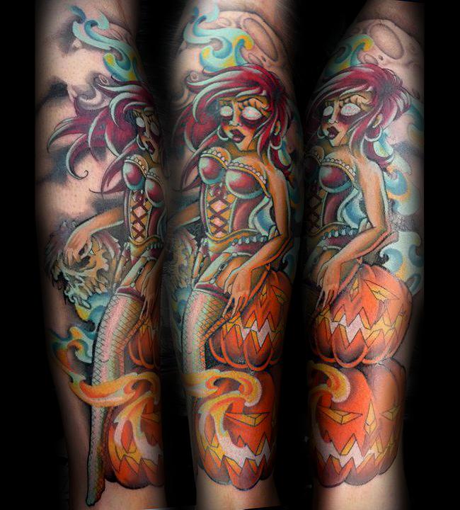 Old school style multicolored sleeve tattoo of demonic mermaid with Halloween pumpkins and skulls