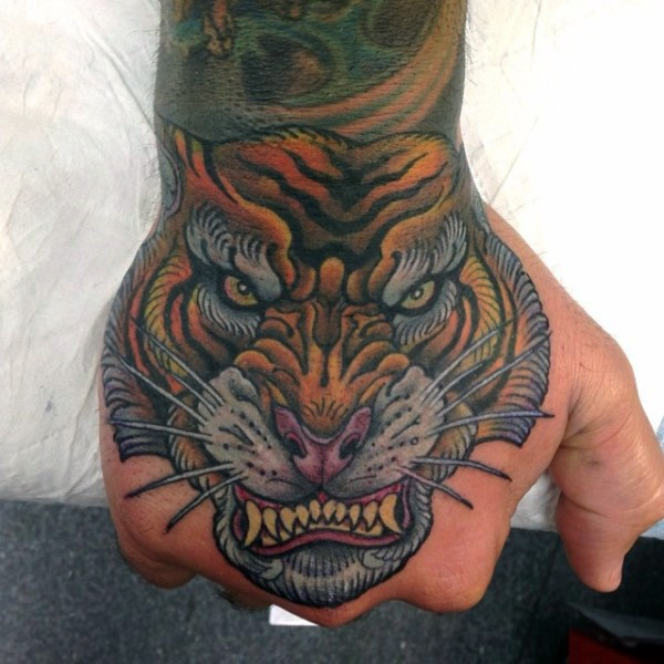 Old school style naturally colored furious tiger&quots head tattoo on hand