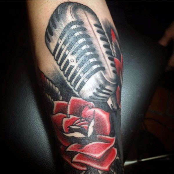 old school style painted and colored microphone with flower tattoo on arm. Black Bedroom Furniture Sets. Home Design Ideas