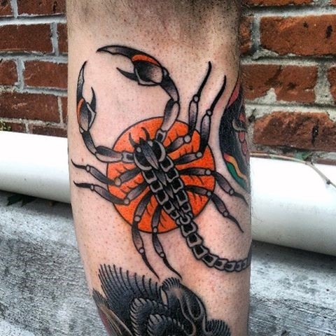 Old school style painted and colored big scorpion tattoo on arm