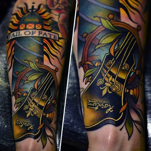 Old school style painted and colored guitar with lighthouse tattoo on arm