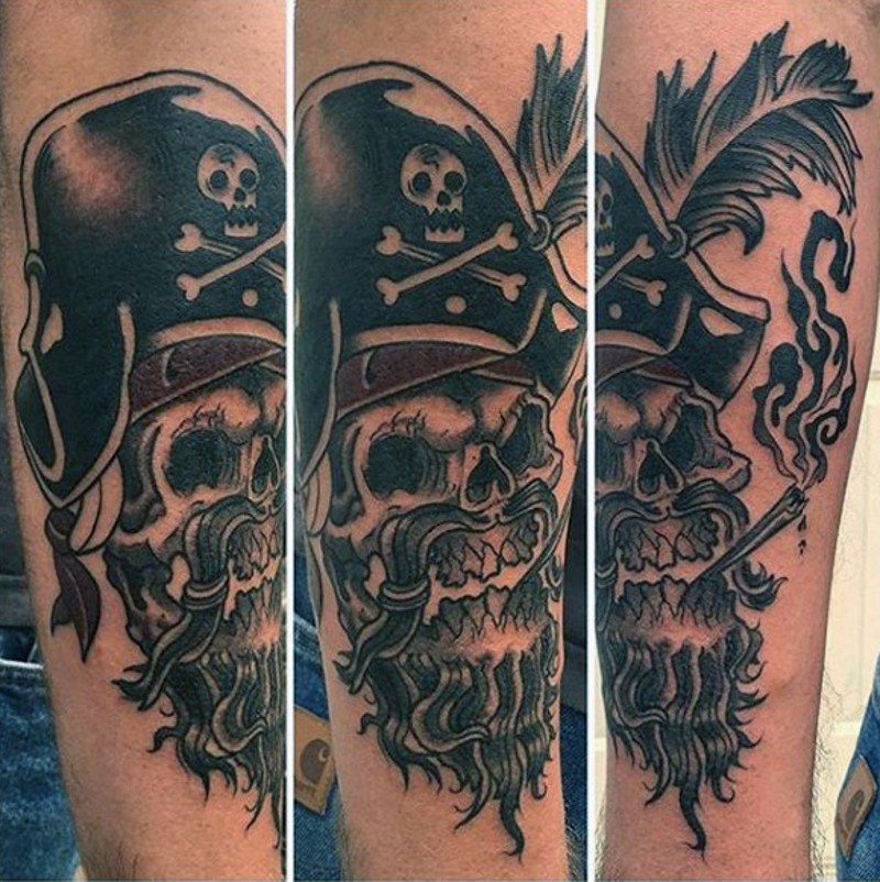 Old school style painted black and white pirate skeleton tattoo on arm