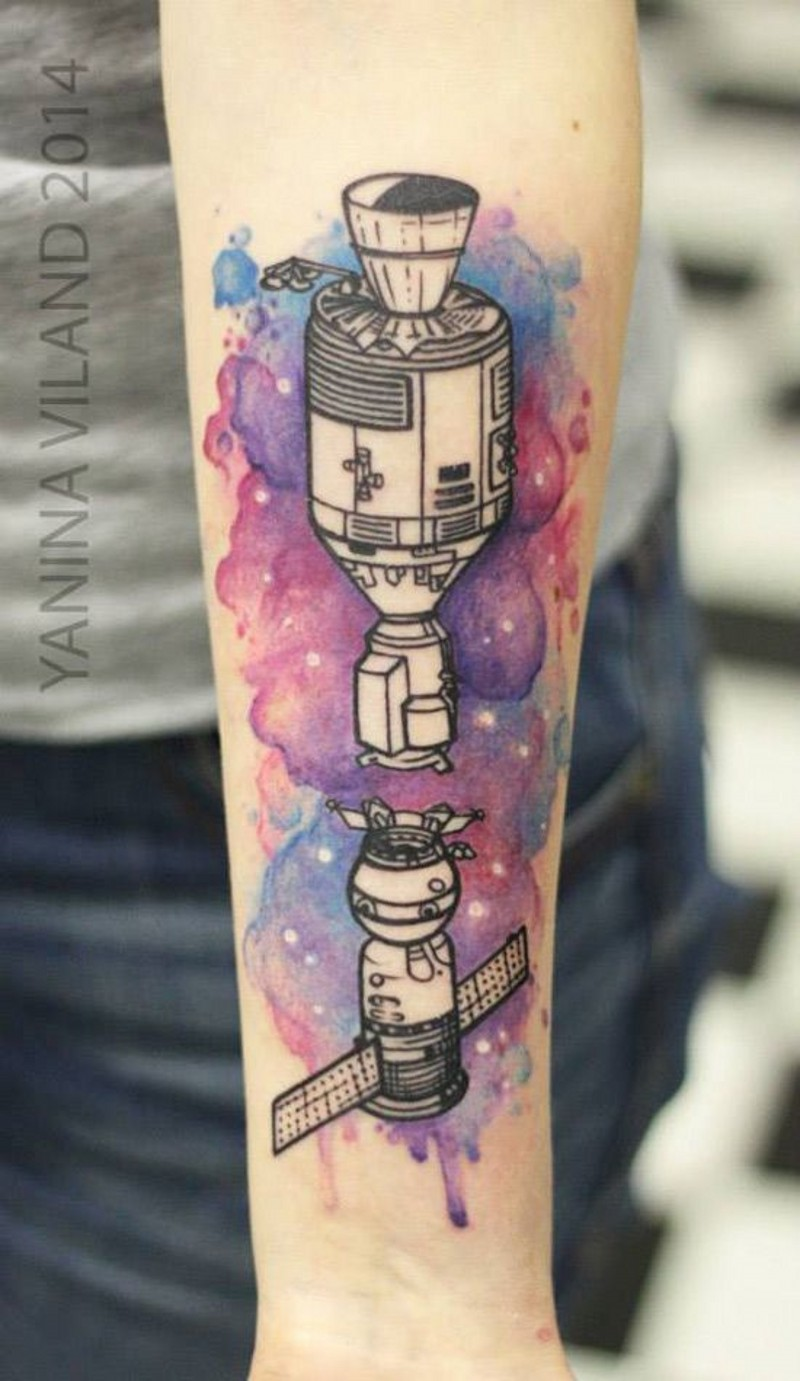Old school style painted colored space ships tattoo on arm