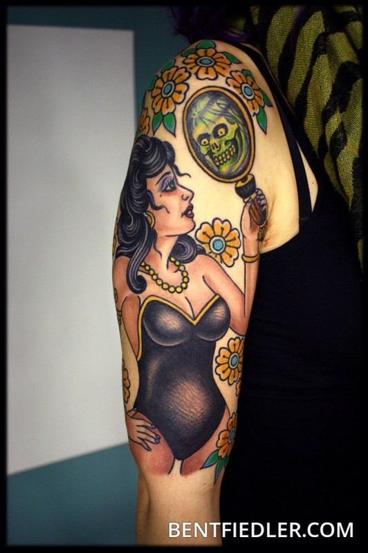 Old school style painted colored woman with mirror and flowers tattoo on shoulder