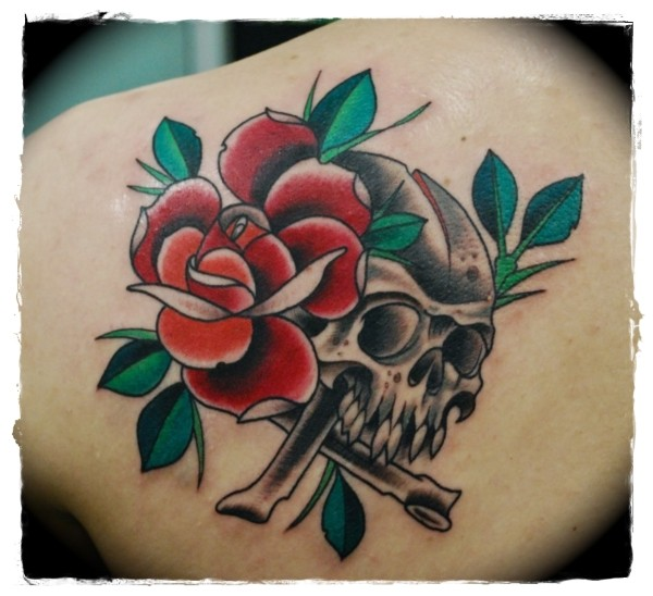 Old school style painted red rose with skull tattoo on shoulder