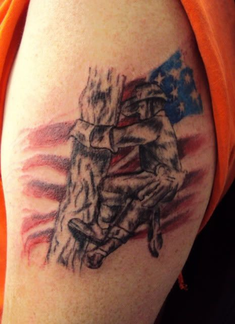 Old school style small shoulder tattoo of American soldier lineman