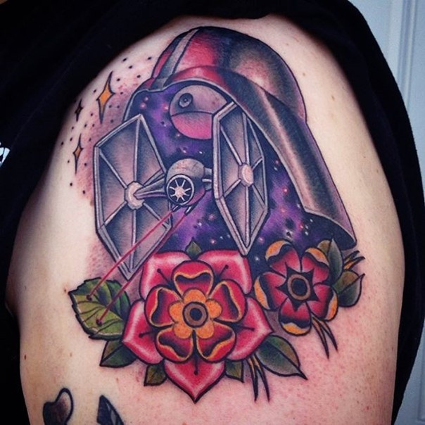 Old school style Star Wars themed colorful tattoo on shoulder with flowers and stars
