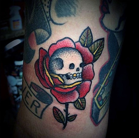 Old school traditional red rose with small skull colored tattoo