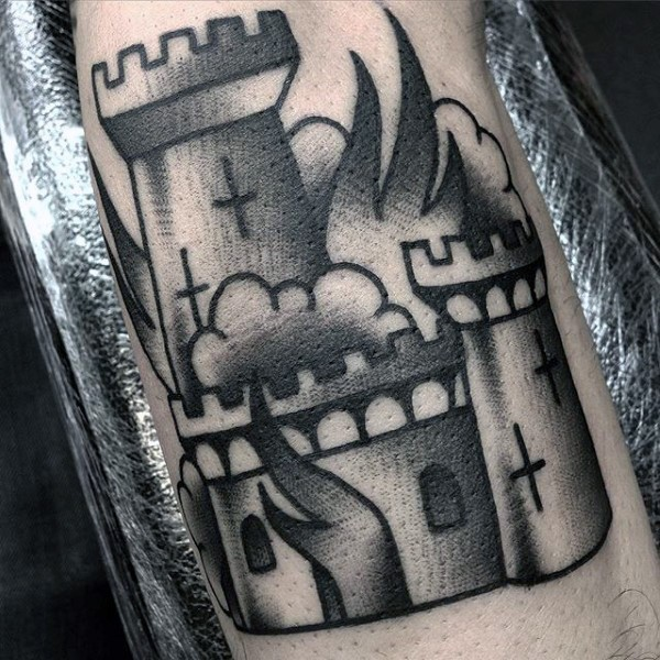Old style black and white castle with crosses on fire tattoo