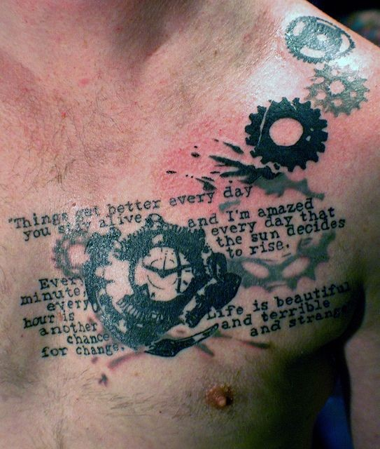 Old style black and white lettering tattoo on chest